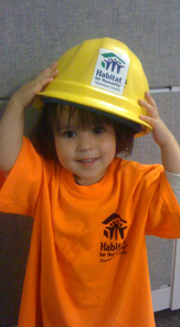 Getting ready to build! One of our partner family children, wearing her parent's hardhat.
